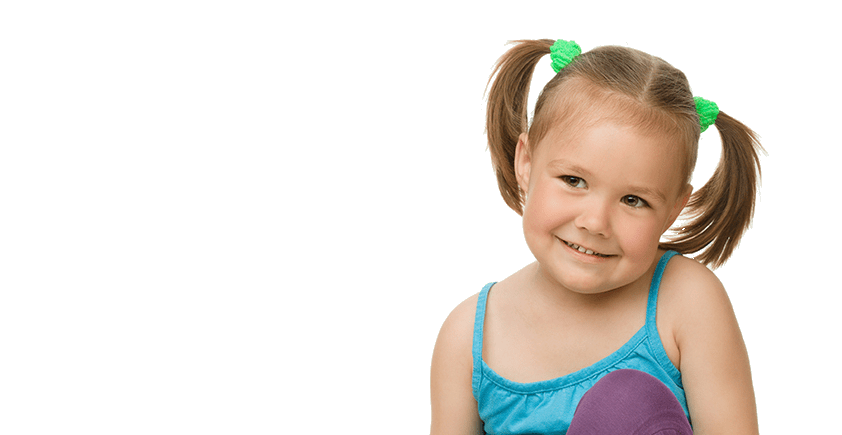 a young girl with pigtails smiles